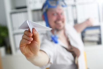 Man wearing suit and tie in goggles and snorkel play with fly paper plane in office closeup. Count days to leave annual day off workaholic freedom fun tourism resort idea ticket sale overseas concept