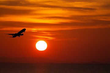 airplane taking off airport sky-diving industry cargo business, concept: passenger Commercial  modern navigable Travel and business,Silhouette aircraft is flying above skyline sun