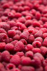 View of heap of raspberries as textured background
