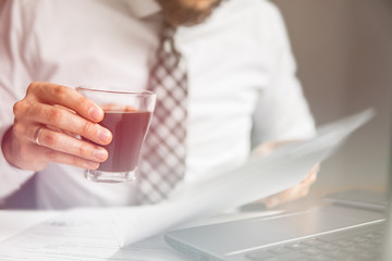 Light background. Businessman work with computer on table in office work. Financial business. Close up Documents in hand Young bearded businessman Office work with a laptop.