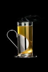 Tea glass with metal cap holder
