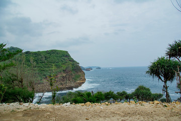 timang beach with beautiful view waves and cliffs