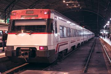 Locomotive at train station. Railway station.