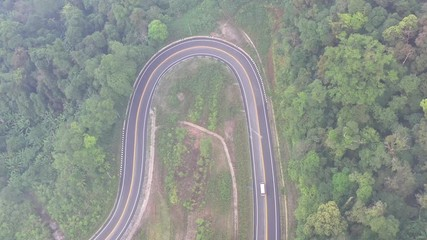 Fotomurales - Aerial top view of a road in the forest