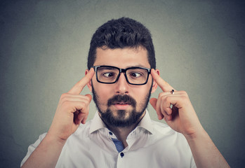 Man in glasses with strabismus