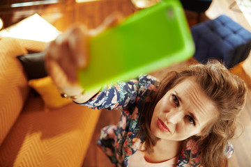 unhappy housewife having wifi low signal issue on smartphone