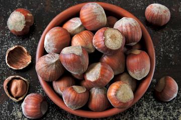 Hazelnuts in a bowl. Fresh hazelnuts in the shell.