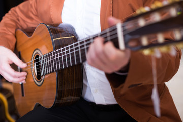 Male musician performing on guitar