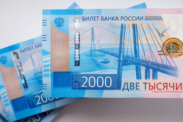 Russian banknotes 2000 rubles. The banknotes depict the bridge to the Russian island in Vladivostok. View from the top. Close-up