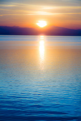 Tuinposter Zee zonsondergang atardecer en el mar en calma