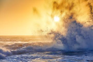 Splash water at sunset