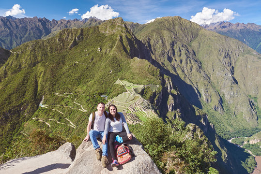 Young couple on Machu Picchu background