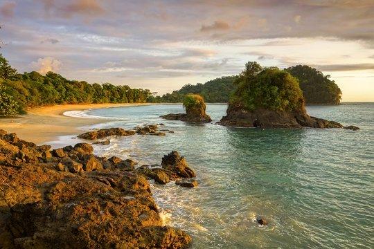 Scenic Sunset View and Dramatic Landscape of Playa Espadilla Beach in Manuel Antonio National Park Costa Rica