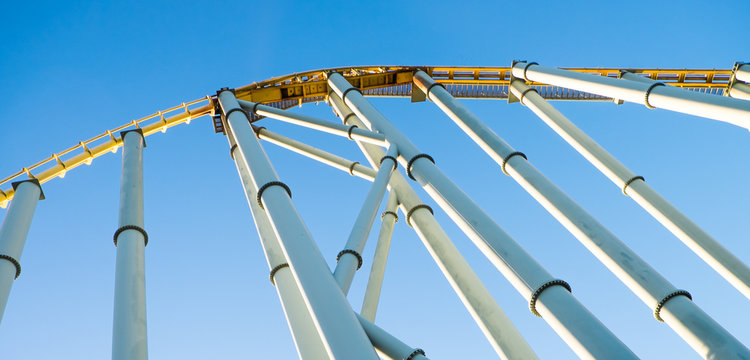 View from below of roller coaster about to drop