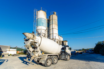Mixer for transportation of concrete on the background of mortar concrete unit, shop for the production of concrete products. Concrete truck