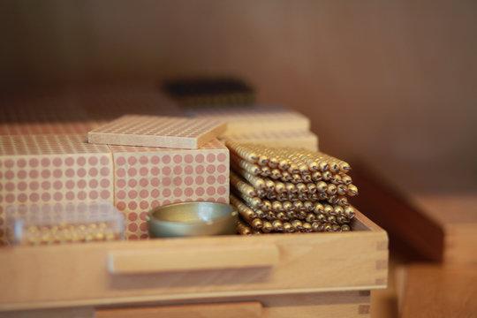Montessori golden bead material in a classroom