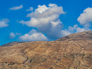 Yellow rocky hills and blue sky above