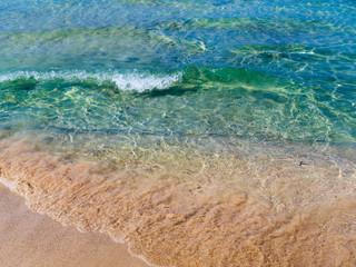 Beautiful azure blue water and orange beach sands