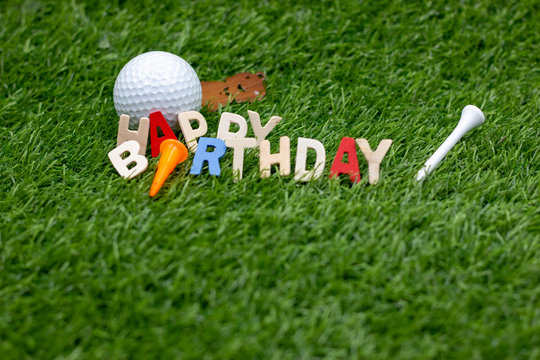 Happy Birthday to golfer is on green grass with golf ball and teee