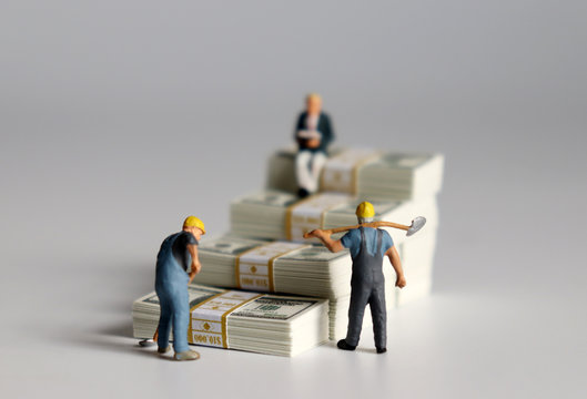 Miniature people. The banknotes in the shape of a staircase.