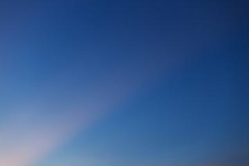 sunray on clear twilight sky background