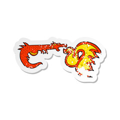 retro distressed sticker of a cartoon fire breathing dragon