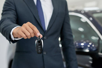 Car seller giving keys
