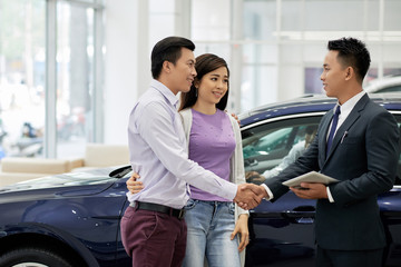 Husband and wife buying car