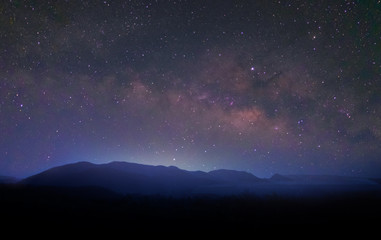 milky way,starry night landscape over mountion