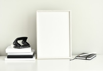 Black and white work space, blank photo frame, office supplies, styled photography.