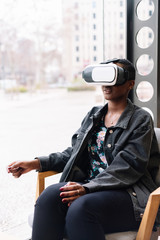 Young woman experimenting with virtual reality