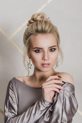 portrait of fashionable attractive woman close up face, beautiful blonde with bright makeup and hairstyle
