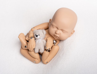 Toy of newborn baby for photo practice