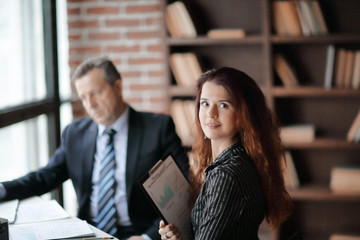 employee of the company with financial documents in the office