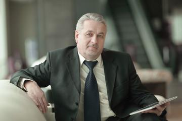 adult businessman looking at digital tablet screen