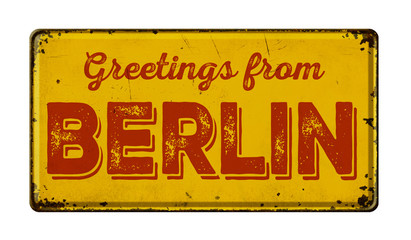 Vintage metal sign on a white background - Greetings from Berlin