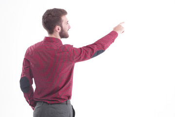rear view.a successful employee pointing towards the copy space.isolated on white.