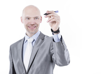 serious businessman pointing a marker at the virtual point.i