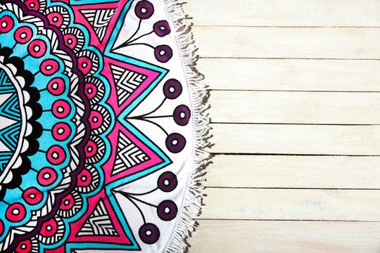 Beautiful round bright beach towel with mandala