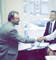 handshake financial partners prior to discussion of the transact