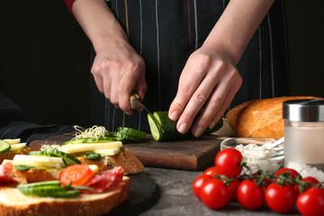 Keuken foto achterwand Koken Woman preparing tasty bruschettas