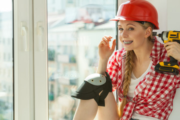 Woman pointing at her head with drill