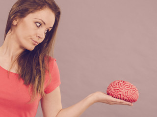 Woman holding brain thinking