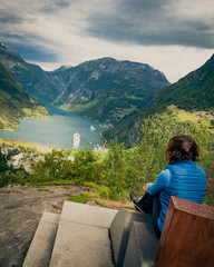Tourist enjoying Geirangerfjord from viewing point