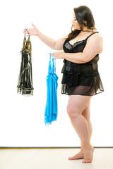 Plus size woman fitting satin nightwear