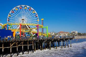 santa monica pier amusement park with coaster and big wheel