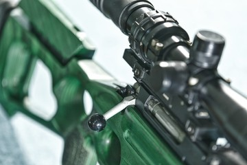 Closeup of sniper rifle piece. riflescope and butt. Russian weapons theme