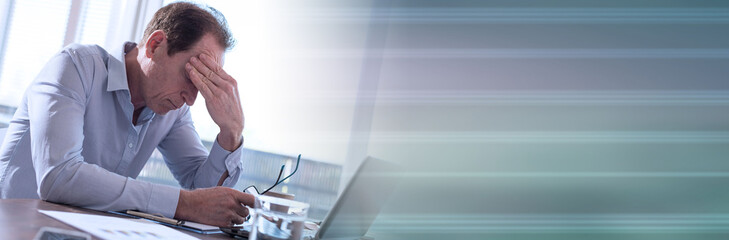 Stressed businessman sitting in office. panoramic banner
