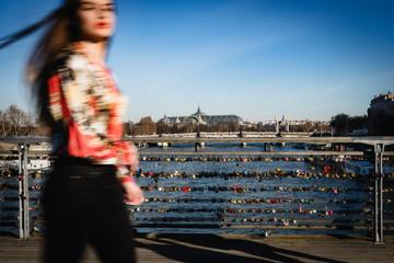 Young woman on a parisian bridge