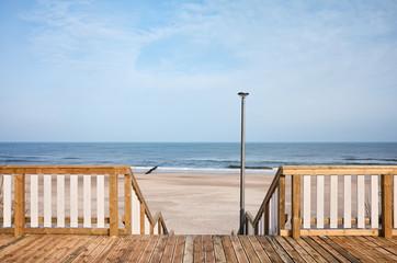 Wooden boardwalk with a beach entrance
